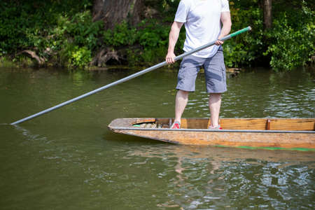 Detail Of Man In Punt On River Cherwell In Oxford 写真素材