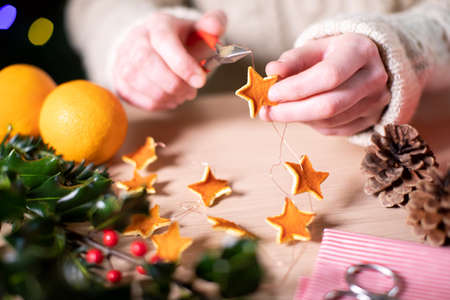 Close Up Of Woman Making Eco Friendly Eco Christmas Decorations From Orange Peel