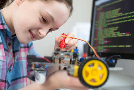 Female Pupil Building Robotic Car In Science Lesson