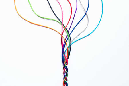 Coloured String Woven Together To Illustrate Concepts Of Unity Society Togetherness and Cooperation Standard-Bild
