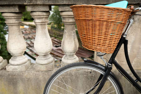 Old Fashioned Bicycle On Magdalen Bridge Over River Cherwell In Oxford With Punts Moored In Background 写真素材