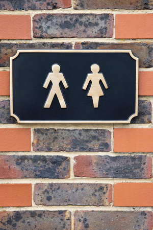 Sign Of Male And Female Figures Outside Public Toilet To Illustrate Gender Issues