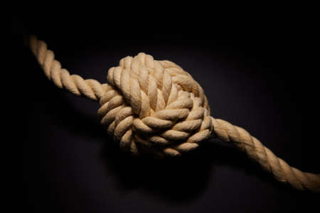 Concept Shot Of Rope Tied With Knot On Black Background To Illustrate Problem Or Mental Health Issue Imagens