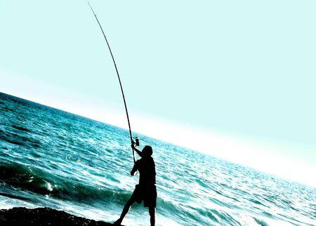 diagonally: fisher at the sea