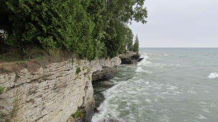 Waves crashing into limestone cliffs