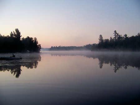 Calm lake at dusk Stock Photo