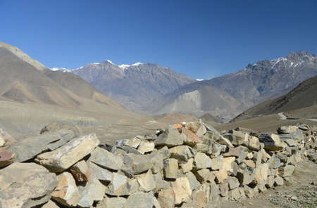 porter house: Stone side road wall in Himalayas. November 2014