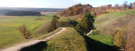 Landscape of the medieval Lithuanian capital Kernave from above with mounds sunken in fog. 2 part