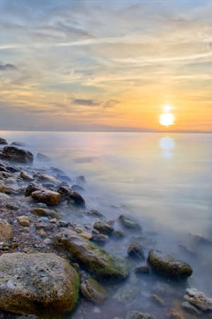 Beautiful seascape. Sea and rock at the sunset. Nature composition