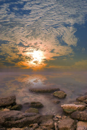 windless: Rocks, sea, sunset and windless calm weather