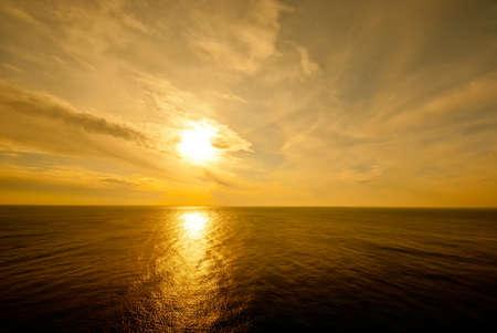 the sun setting over the Black sea photo
