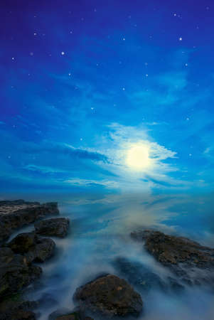 night seascape with the stars and the moon photo