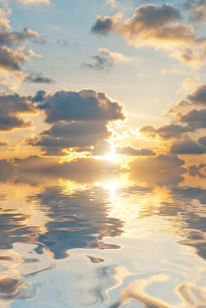 bright sunset and clouds at calm sea background