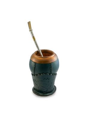 Calabash cup using a metal or wood decorative straw. Vertical image photo