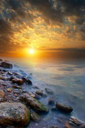 The edge of the beach, sea, sunset. The natural landscape photo