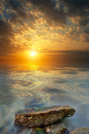 Large stone, sea, sunset. The natural landscape photo
