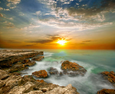 Sea cliffs and sunset over the sea. The natural composition photo