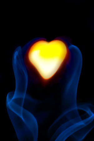 Abstract heart on a black background in the blurry smoke Stock Photo - 21958880