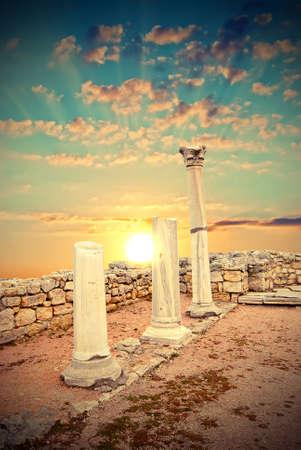 Ancient Greek columns at sunset. City of Sebastopol. Chersonesos. Vintage style Stock Photo