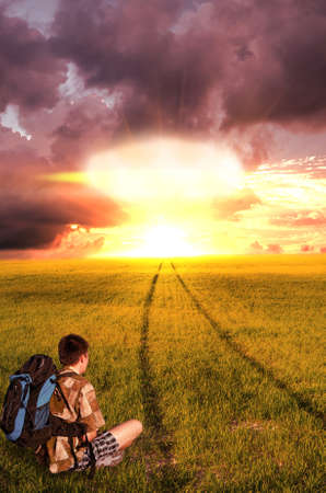 dystopia: Nuclear explosion and the young man did not reach his goal, sitting and looking hopelessly at the  end of life   beginning of the End Stock Photo