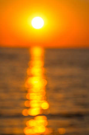 Blur solar path on the sea during sunset. abstract composition photo