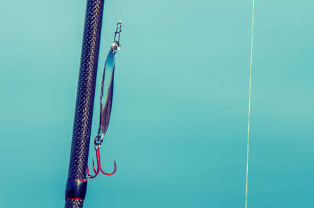 jigging: Carboxylic fishing rod with fishing line and lure. Vintage style Stock Photo