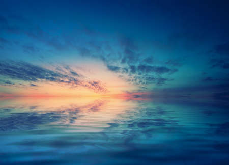 transmitted: Dawn over the calm Black sea and small waves. Romantic mood transmitted color palette pictures Stock Photo