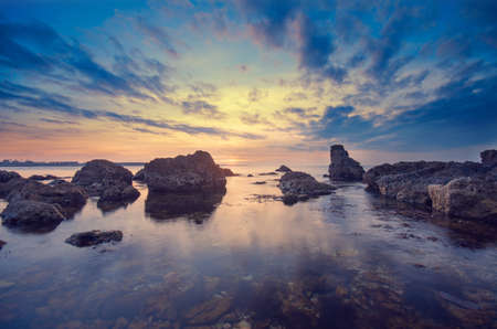 unusually: Big stones, sea and unusually sunset. The natural landscape Stock Photo