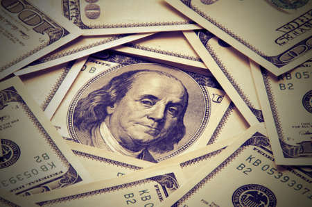 plurality: The concept of a plurality of one-hundred dollar bills with a portrait of Franklin in the center. Vintage composition