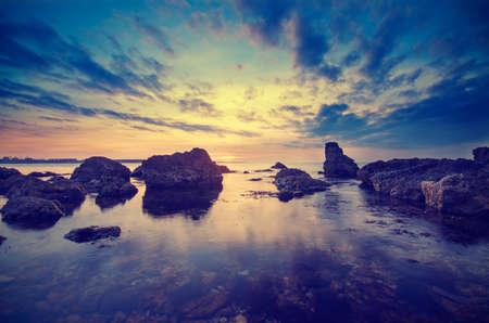 Enchanting sunset on the Black Sea near Sevastopol. Vintage composition