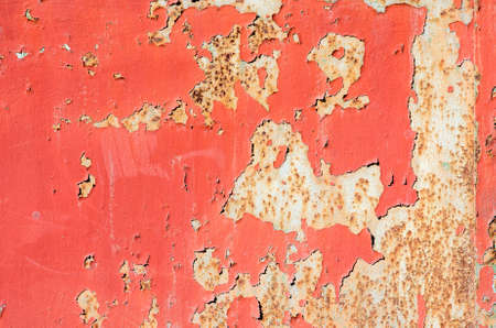 seamless red cracked paint grunge on iron background.  texture composition