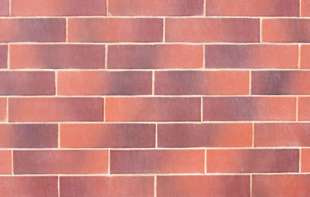 textural: Wall of red decorative bricks. textural composition