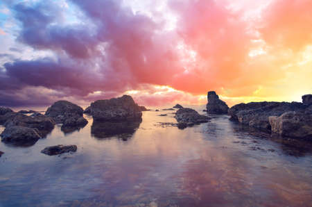 unusually: Big stones, sea and unusually dramatic sunset. The natural landscape