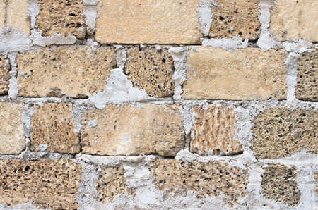 porous brick: Part of the wall from a shell rock and cement. textural composition