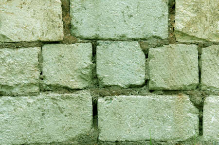 Wall of green brick and cement. textural composition