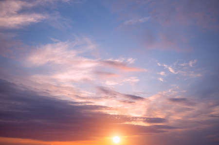 Sunset on the sky, bright sun and colorful clouds. Natural Dawn Composition
