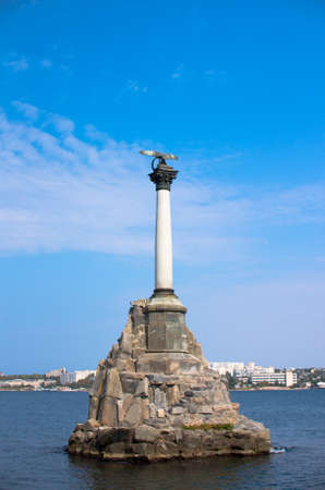 Monument to the flooded ships in Sevastopol on the background of the bay and blue sky. Memorable composition Zdjęcie Seryjne