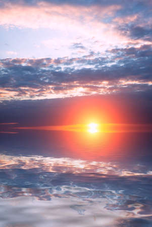 Bright beautiful sun and sunset with clouds over the sea on the calendar. Dawn composition Zdjęcie Seryjne