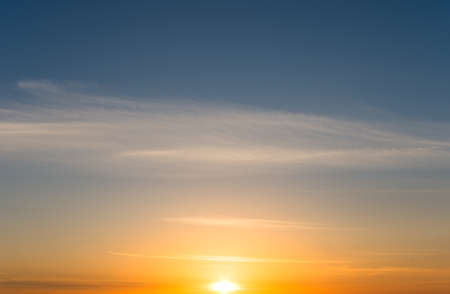 Romantic sunset and cirrus clouds in the blue sky. Dawn natural composition Zdjęcie Seryjne