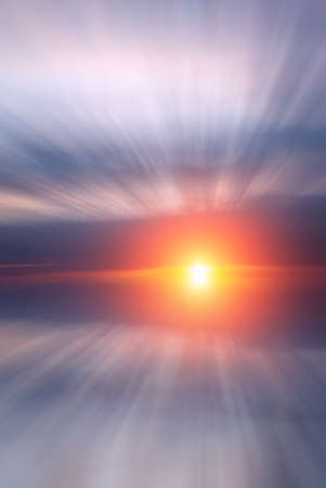 Bright beautiful sun and sunset with clouds over the sea on the calendar. Abstract Dawn composition