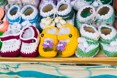 Little baby shoes. Handknitted first sneakers for boy or girl. Crochet handmade shoes with soft soles for toddlers.
