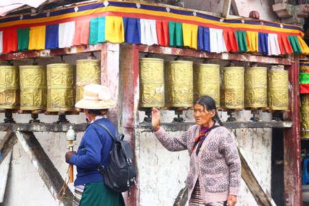 Tibetan turning prayer wheels