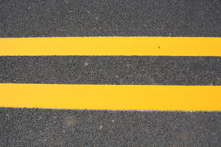 Double Yellow Line On Asphalt Road photo