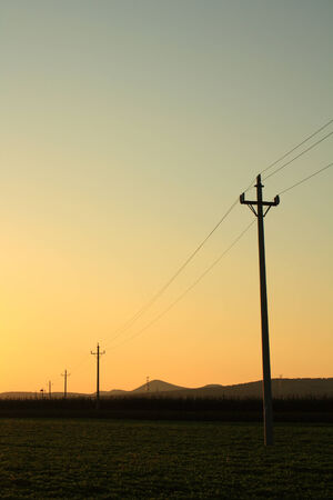 Power pole at sunset photo