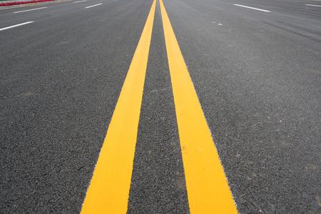 Double Yellow Line On Asphalt Road photo