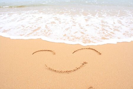 Smiley on the sand photo