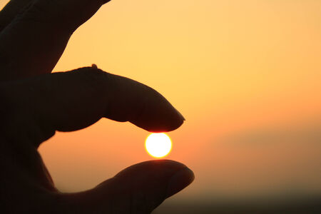 Fingers on sunset photo