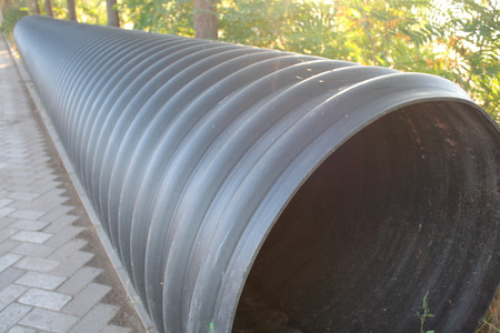 Close up of black plastic pipes photo