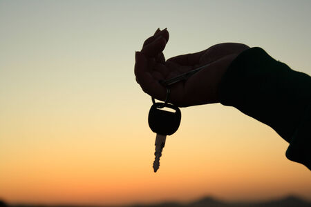 Holding an key silhouette photo