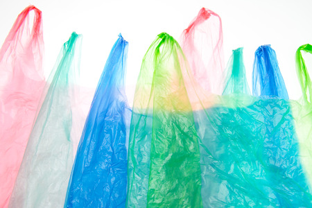Plastic bags on white background Imagens